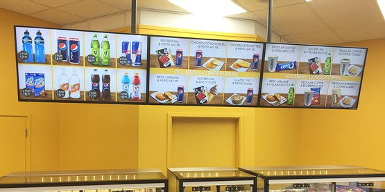 Digital menu boards at Station Mart Convenience Store